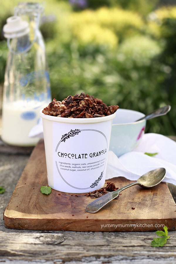 Healthy chocolate granola with nuts and seeds in a container to give as a DIY gift with a printable label.