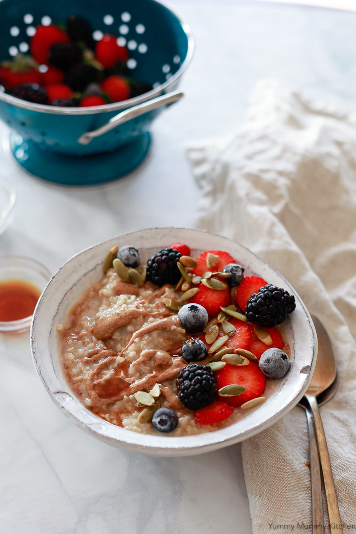 This bowl of steel cut oats was made in the slow cooker and topped with fresh berries.