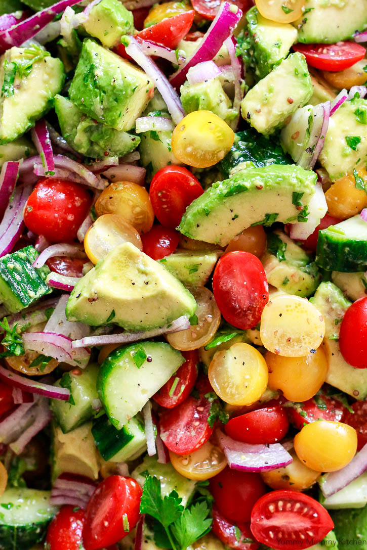 This beautiful avocado salad is simple and easy. Loaded with tomatoes, cucumber, and red onion, and dressed with a mustard vinaigrette, this avocado salad is delicious alone or served with greens or quinoa.