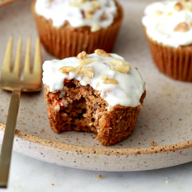 Delicious gluten free vegan carrot cake muffins with cream cheese frosting!