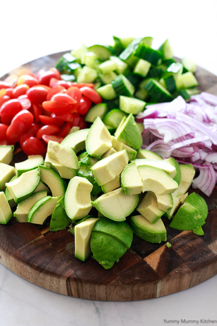 This avocado salad is made with simple, fresh ingredients like cherry tomatoes and cucumber.