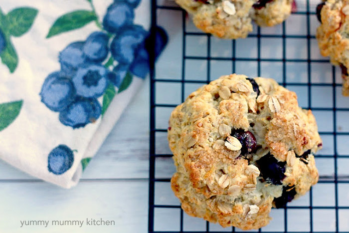 A blueberry oatmeal scone on a cooling rack.