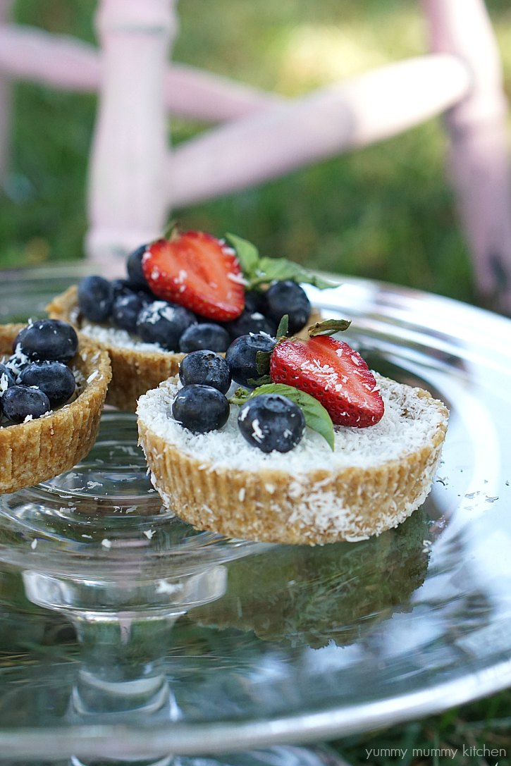 Vegan lemon and coconut tarts with berries