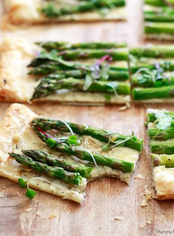 Beautiful square of asparagus tart made with puff pastry, fresh asparagus, and goat cheese.