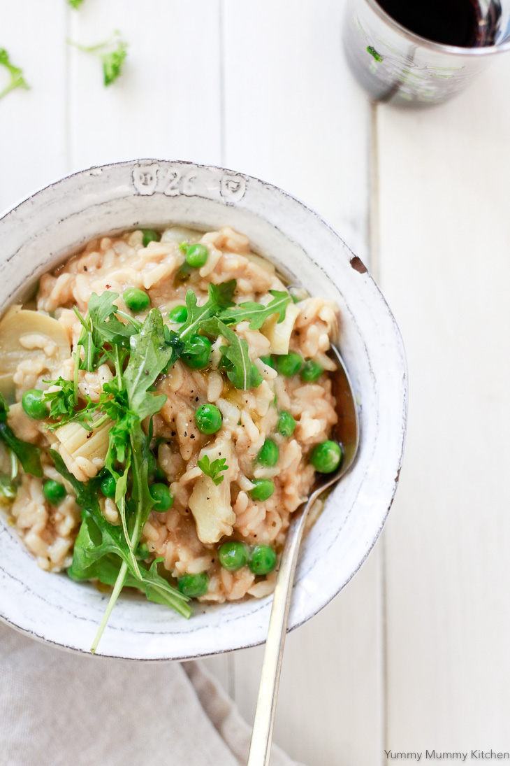 This rustic white bowl of risotto with green peas is an easy and comforting vegetarian and vegan meal made in the Instant Pot pressure cooker.
