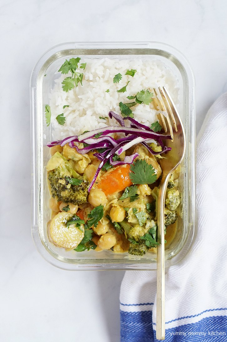 A meal prep bowl filled with rice and chickpea curry that's perfect for weight loss.