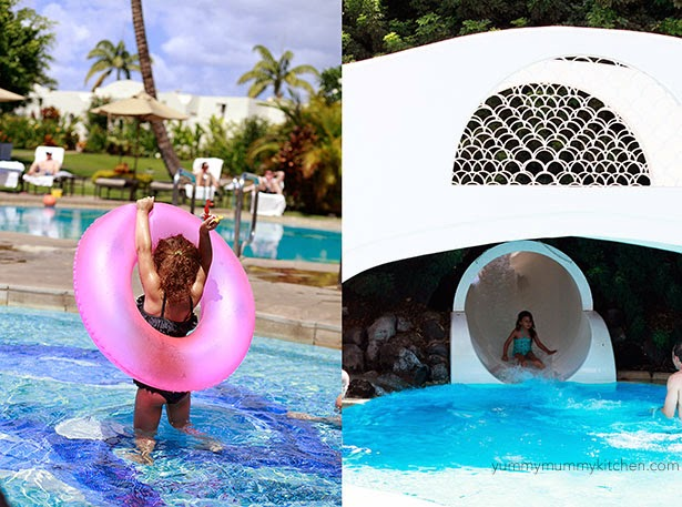 Kids playing at the pool and waterslide at the Fairmont Kea Lani Maui in Wailea.