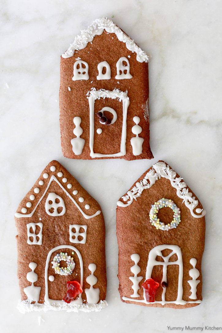Gingerbread house cookies are a fun and easy alternative to making gingerbread houses. These are made with a gluten free, paleo, vegan almond flour gingerbread cookie dough.