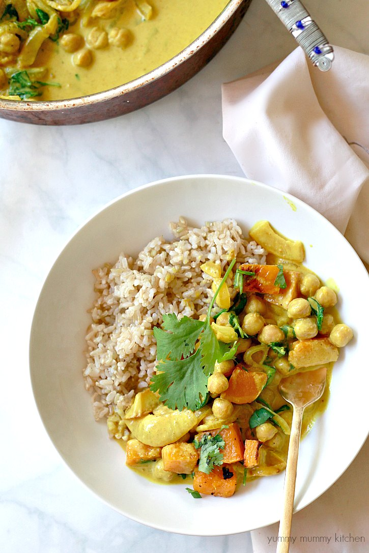 Roasted butternut squash and spinach coconut chickpea curry served with rice makes an easy and healthy vegan dinner.