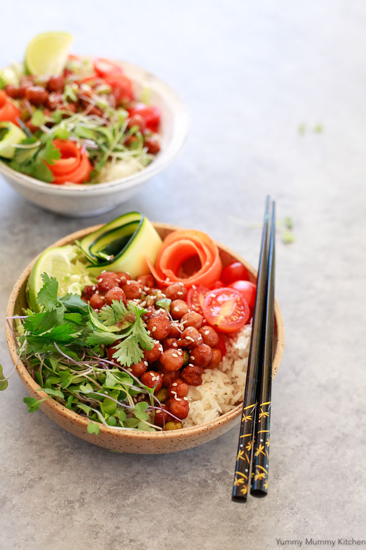 Beautiful rice bowl topped with BBQ chickpeas, sesame seeds, zucchini and carrot ribbons, microgreens, and cilantro. If you're looking for a delicious plant based Buddha bowl, this one is the best!