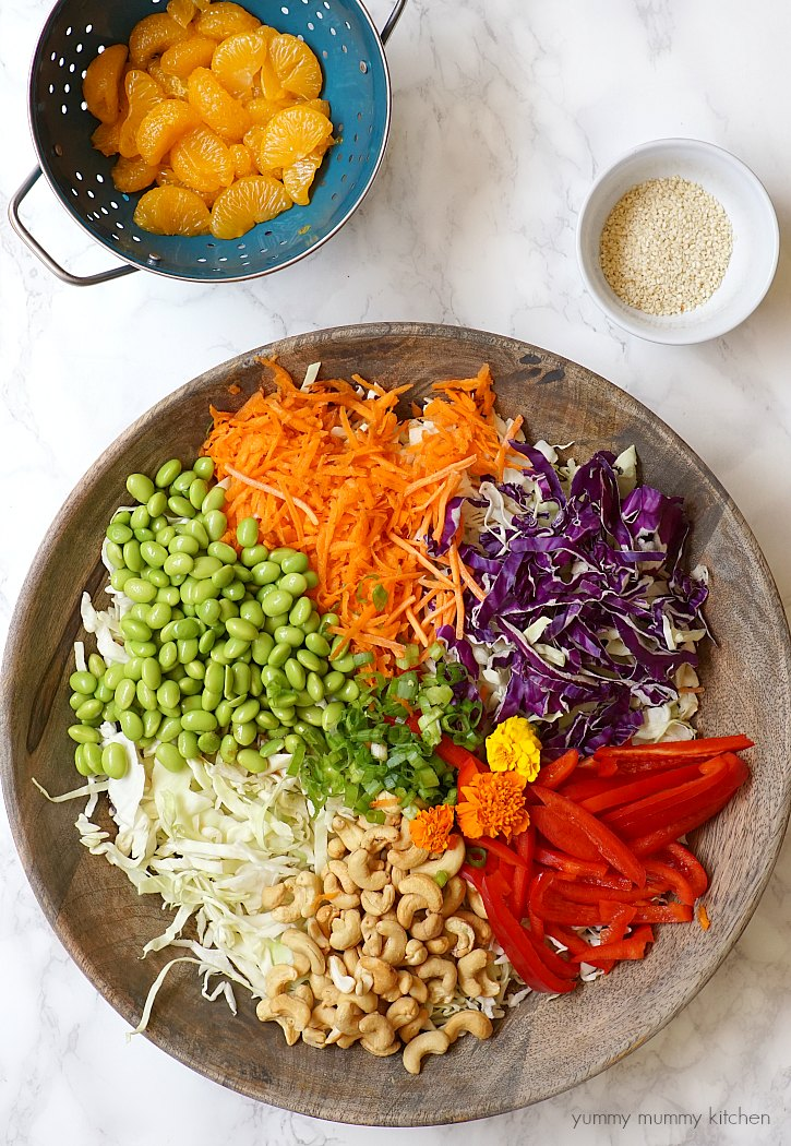 This colorful vegetarian Chinese inspired salad has edamame, cashews, cabbage, mandarin oranges, and a delicious light sesame ginger dressing.