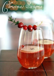 A beautiful glass of red holiday sangria made with cranberry juice and champagne. This easy sangria recipe is garnished with fresh cranberries and rosemary for a beautiful Thanksgiving or Christmas cocktail.