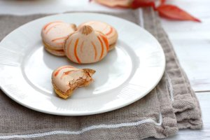 Pumpkin French Macarons on a plate.