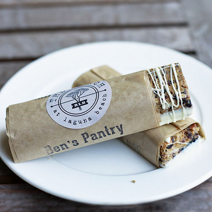 Two granola bars wrapped in parchment from Ben's Pantry at the Ranch at Laguna Beach.