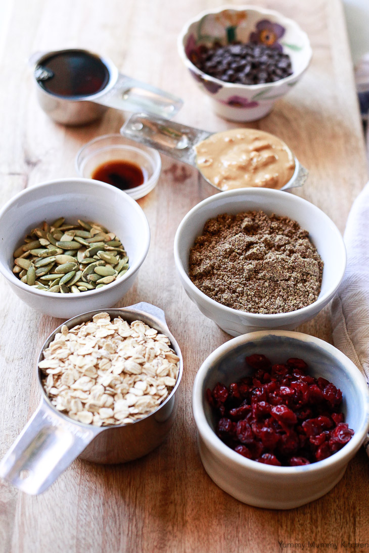 Healthy ingredients like oats, flax, pepitas, and cranberries ready to be made into no-bake energy bars.