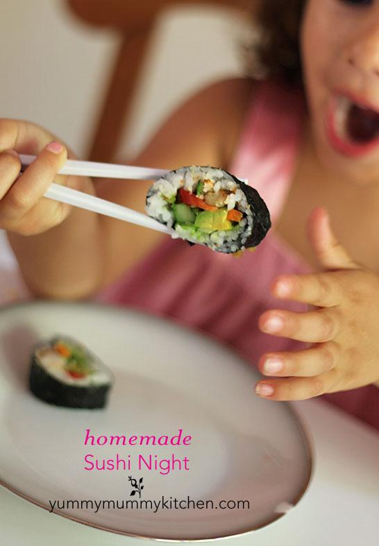 A child picks up a piece of homemade vegan sushi with chop sticks.