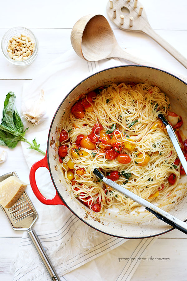 Spaghetti with cherry tomatoes in a le Creuset pot.