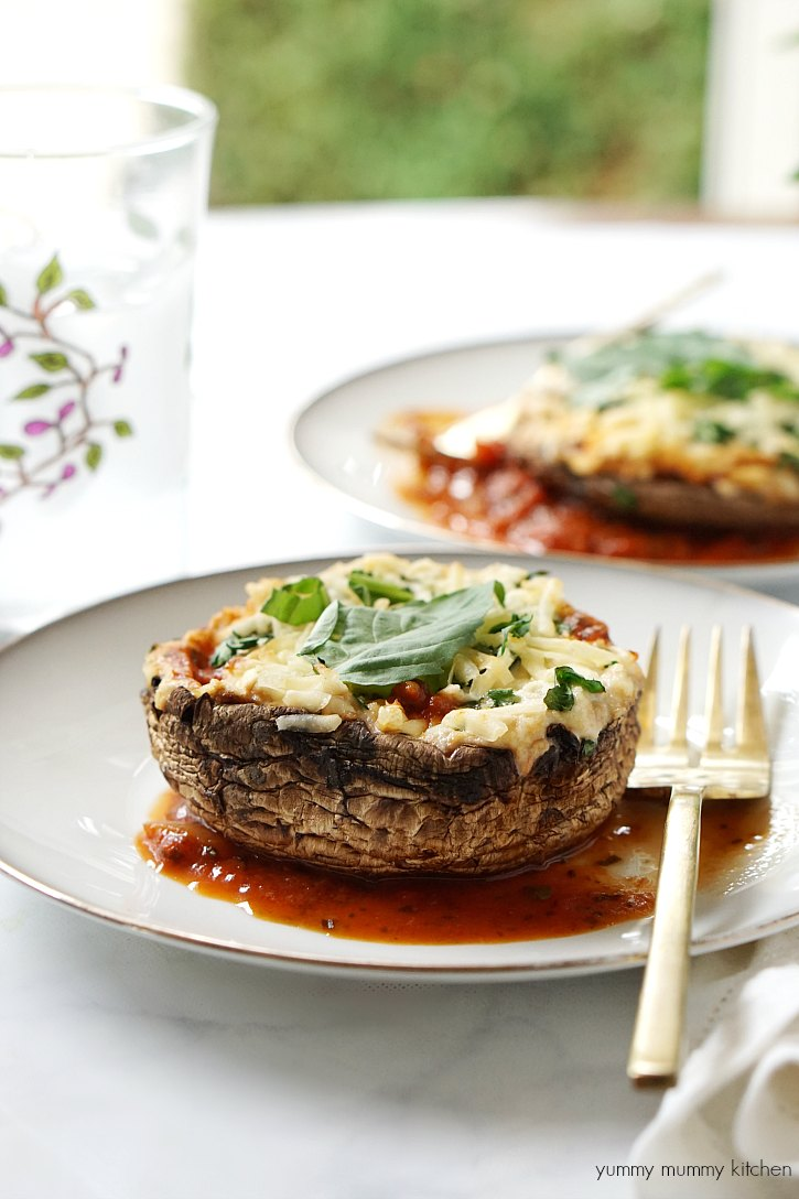 Vegan stuffed portobello mushroom baked with a lasagna filling.