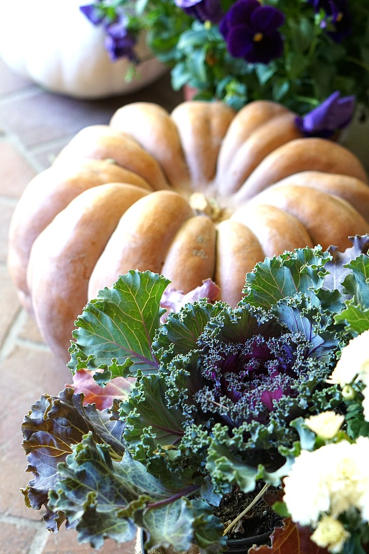 Heirloom pumpkins, kale, and pansies make a beautiful and colorful fall front porch.