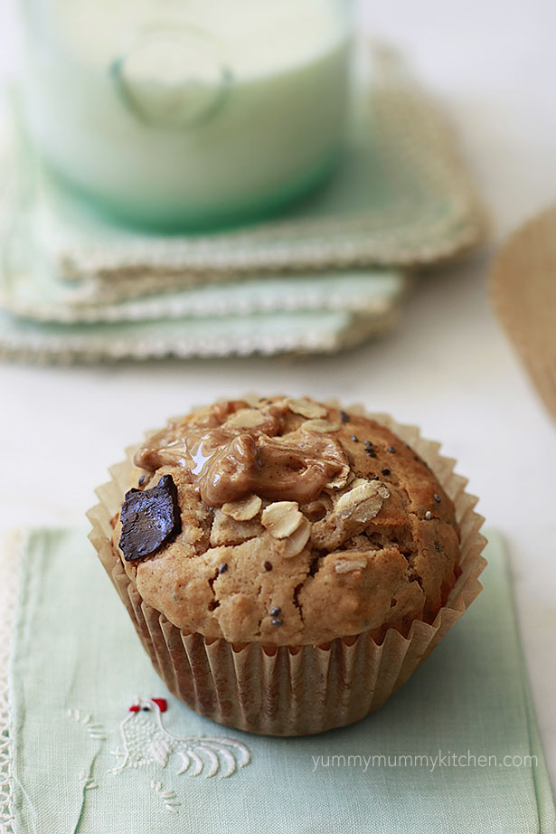 A healthy peanut butter oat muffin with chocolate chunks and chia seeds.