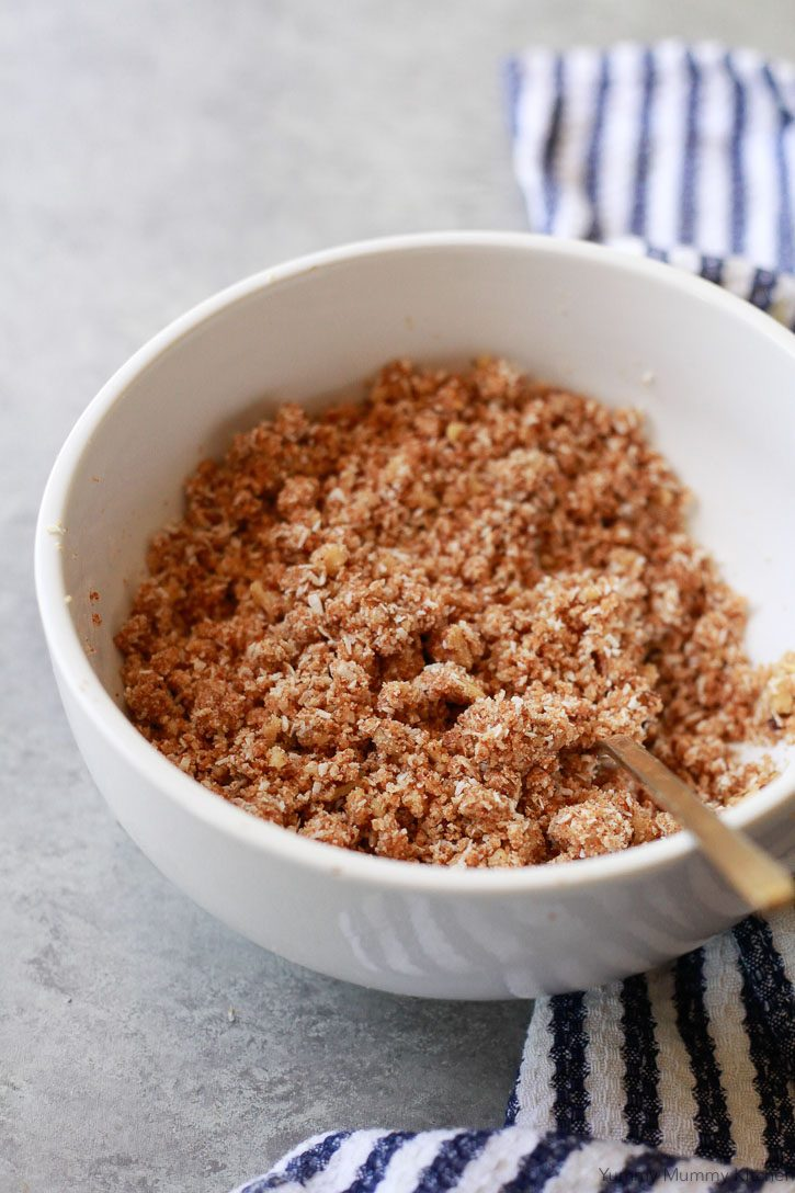 A bowl of healthy strawberry rhubarb crisp topping ingredients