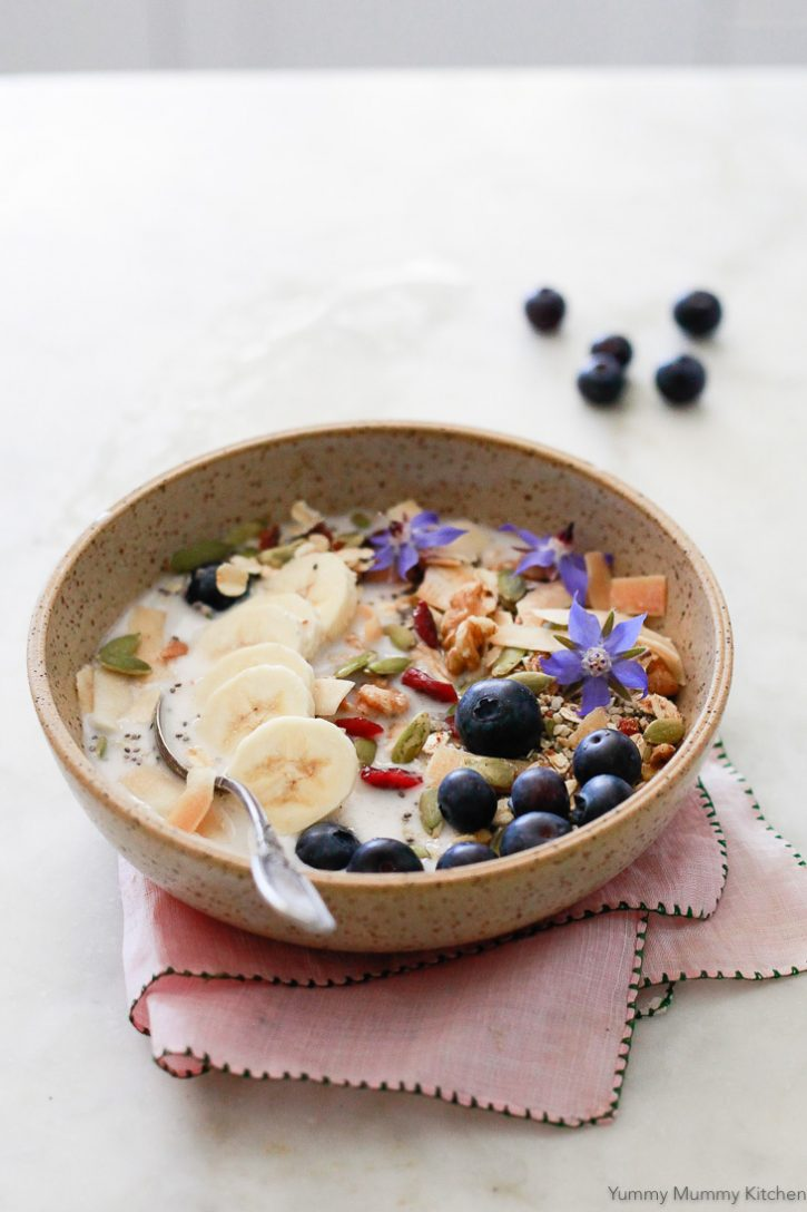 A bowl of superfood Bircher muesli with blueberries and almond milk makes a healthy vegan breakfast.