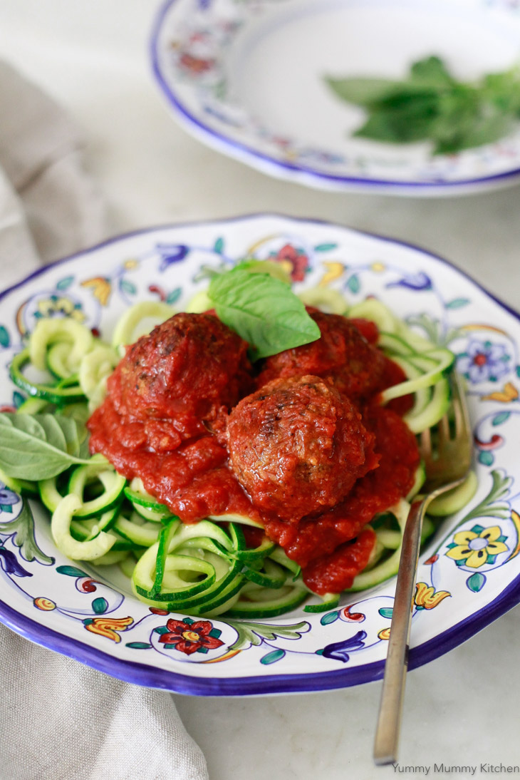 These hearty meatless meatballs are made with lentils, walnuts, and veggies. Packed with Italian flavor, these vegetarian/vegan meatballs are delicious over zucchini noodles, spaghetti squash, or your favorite marinara pasta.