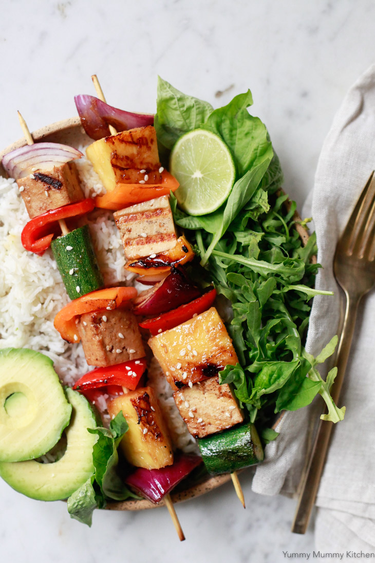 Fresh and colorful vegetable kabobs with onions, zucchini, bell peppers, pineapple and tofu are perfect for an easy vegetarian BBQ or summer dinner.