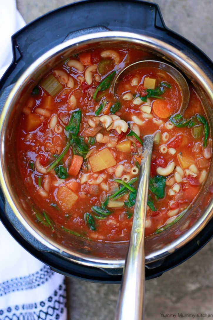 Easy minestrone soup made in the Instant Pot with butternut squash, carrots, celery, spinach, tomatoes, pasta and white beans. Instant Pot minestrone is a wonderful vegetarian dinner recipe.