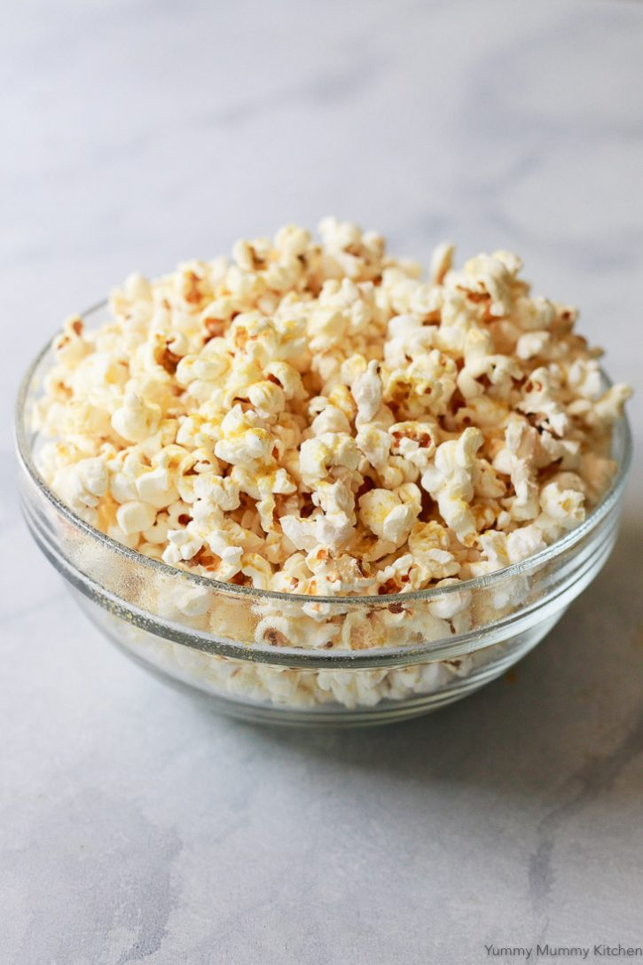 Homemade stovetop popcorn with nutritional yeast and salt is a tasty and healthy vegan snack.