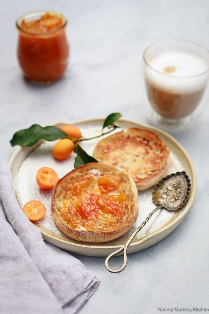 English muffins with homemade kumquat marmalade and coffee make a beautiful breakfast. This easy spiced kumquat marmalade is refined sugar free and easy to make. It's a nice homemade holiday hostess gift too!