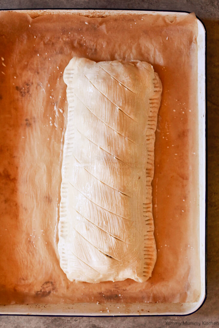 Puff pastry Vegetarian Wellington is brushed with coconut milk and scored before going into the oven.