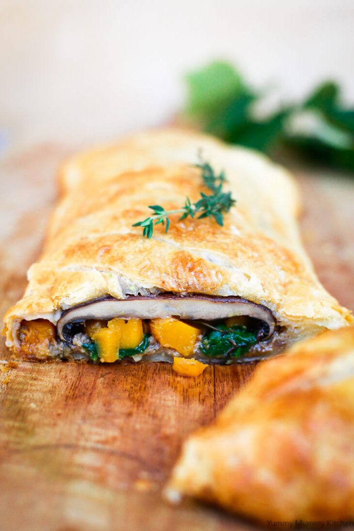 Vegetarian Mushroom Wellington with portobello mushrooms, butternut squash, and spinach in puff pastry is a beautiful vegetarian and vegan Christmas dinner main course.