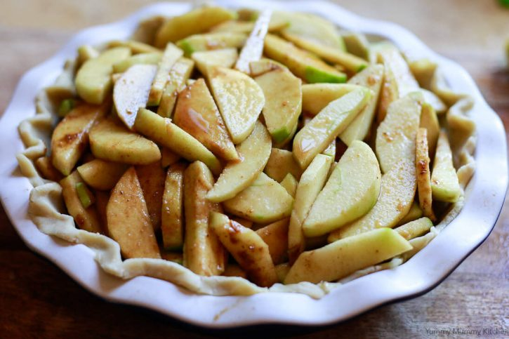 Apple pie filling piled into a pie shell