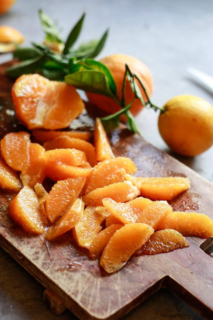 Segmented oranges on a cutting board to add to beet winter salad.
