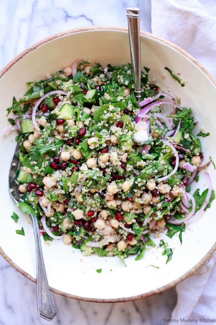 A beautiful vegan chickpea quinoa salad in a white salad bowl.