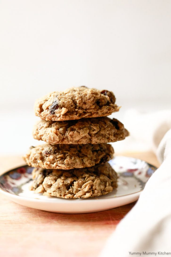 A stack of chewy classic oatmeal raisin cookies on a small plate. These perfect oatmeal cookies are vegan and gluten free.