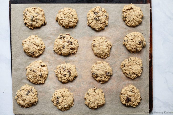 Vegan gluten-free oatmeal cookies on a cookies sheet.