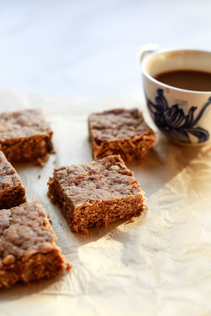 Lightly sweetened peanut butter, date, and oat snack bars are like a less sweet granola bar meets snack cake. They make a delicious snack or breakfast treat.