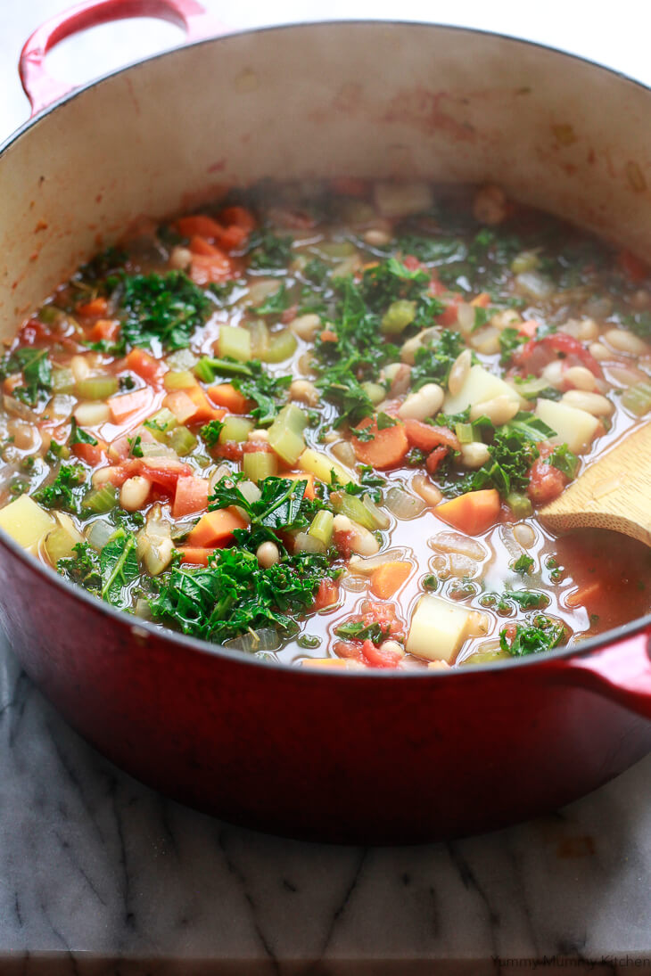 A hearty and healthy winter white bean and kale vegetable soup. White bean and kale soup makes a warming lunch or dinner that's naturally plant-based, vegetarian, vegan, and gluten-free.