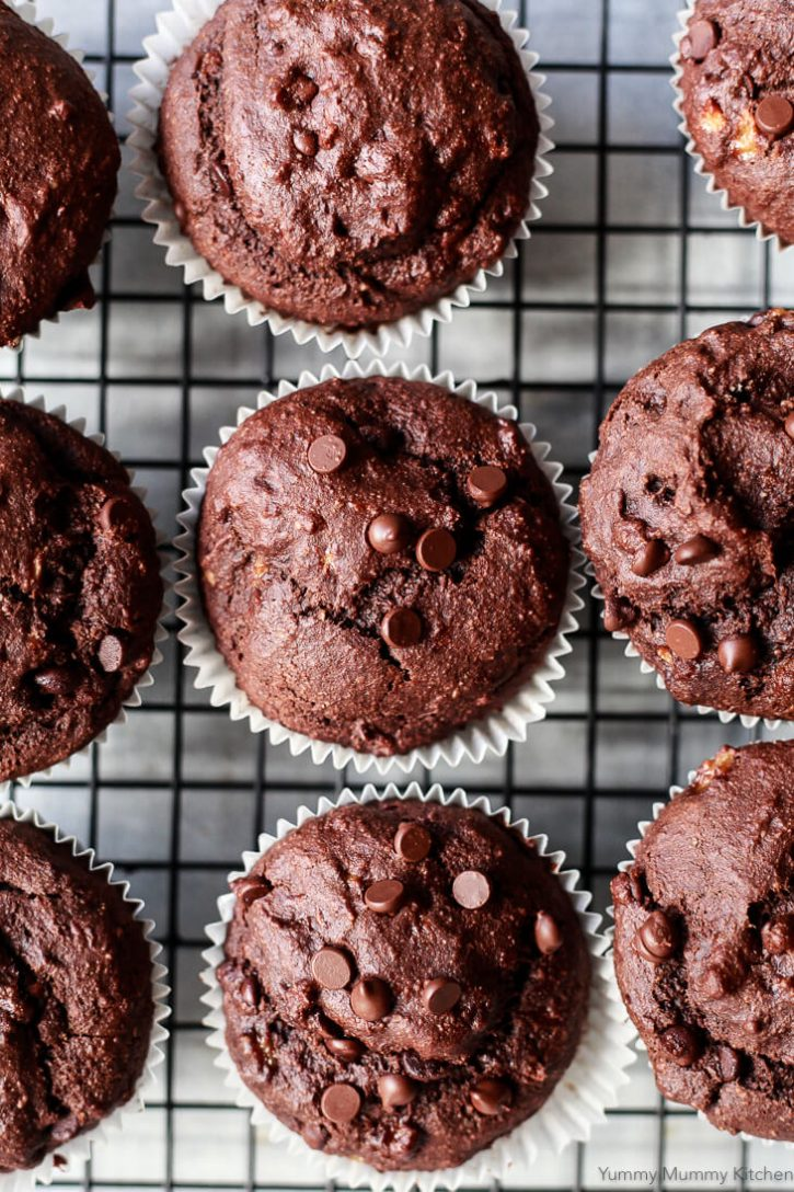 Chocolate banana muffins on a cooling wrack photographed from above. These delicious vegan gluten free chocolate banana muffins are topped with chocolate chips.