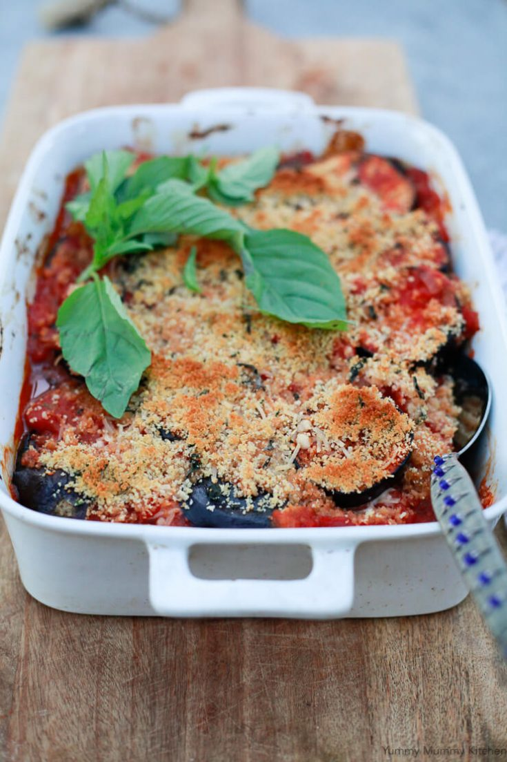 A healthy baked vegan Eggplant parmesan recipe that makes a delicious vegetarian or vegan Italian family dinner.