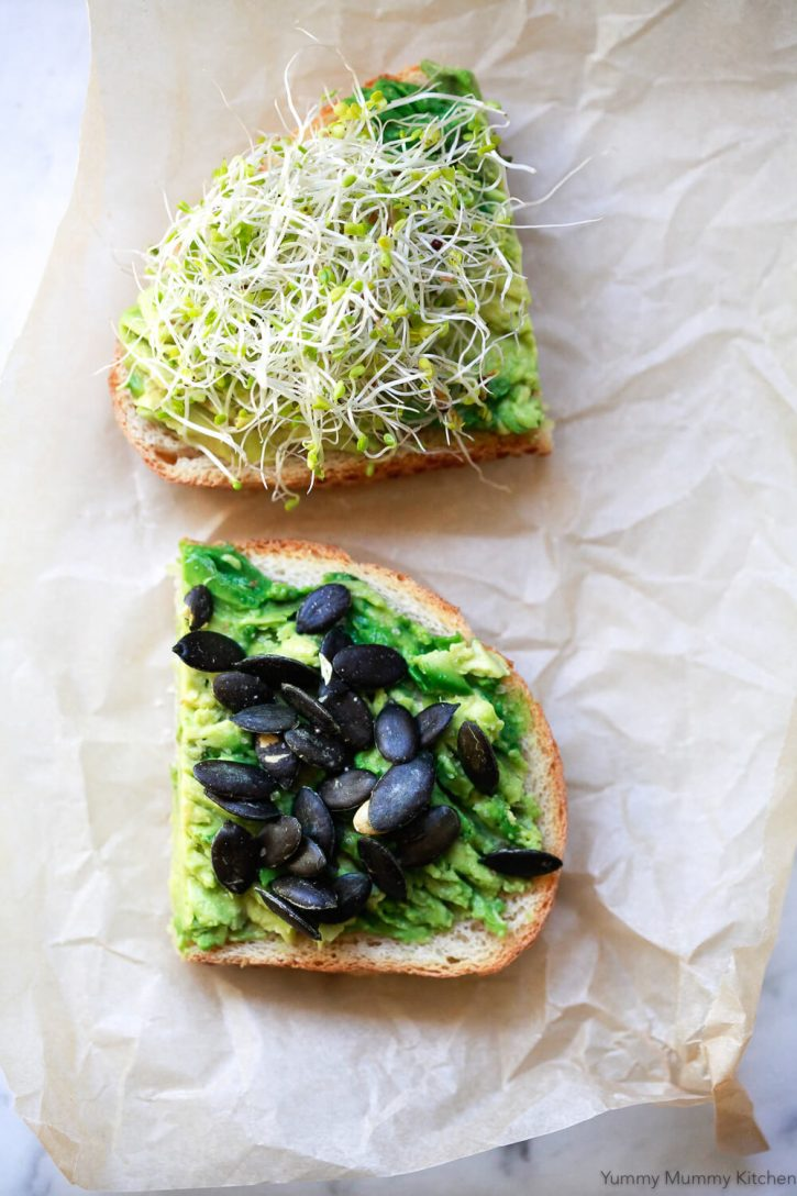 Avocado toast with pumpkin seeds and sprouts.