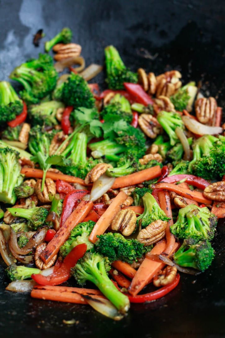 A black wok filled with stir fry vegetables.