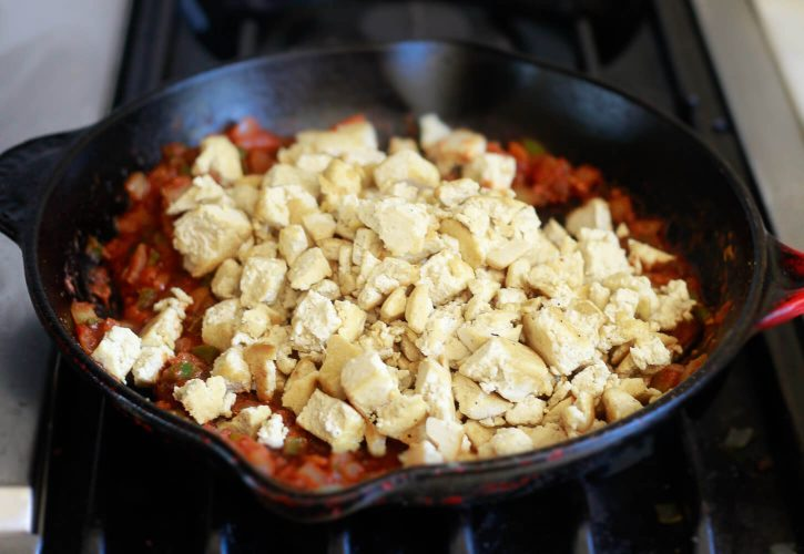 Crumbled tofu is added to a chipotle sauce for making sofritas.