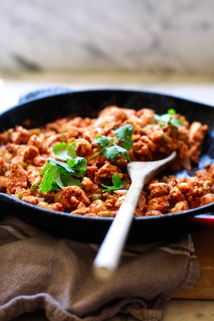 A skillet filled with Chipotle sofritas, a crumbled Mexican tofu recipe.