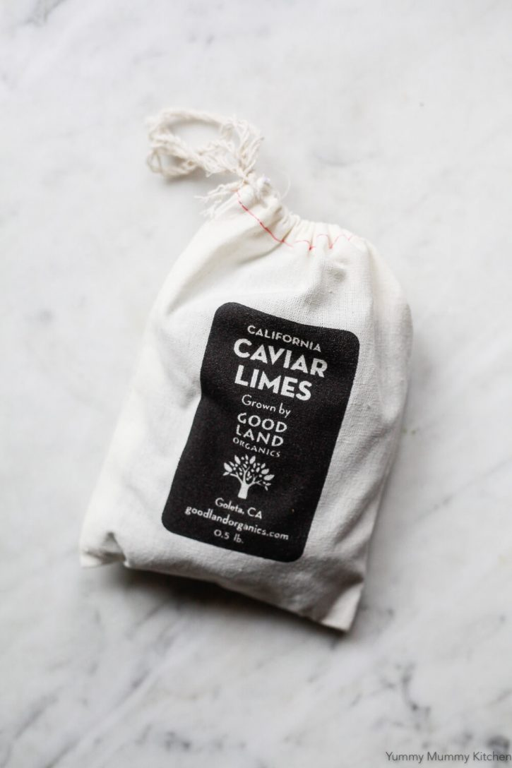 A canvas bag filled with caviar limes from Good Land Organics, sold by Fruit Stand.
