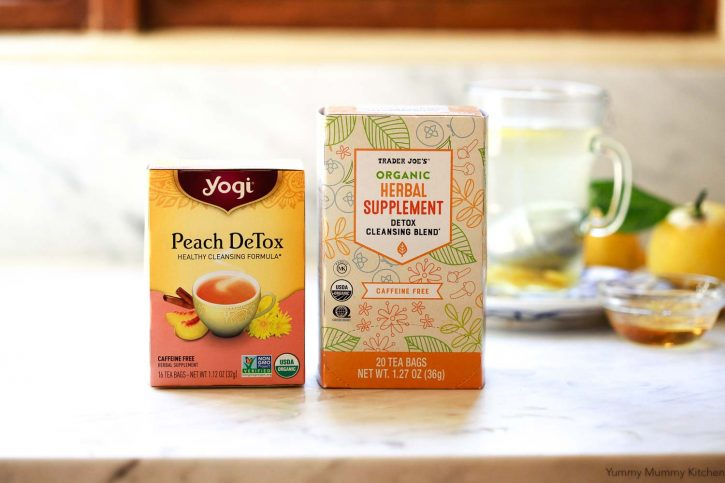 Boxes of Yogi Detox Tea and Trader Joe's Detox Cleansing Blend Tea on a white kitchen countertop.