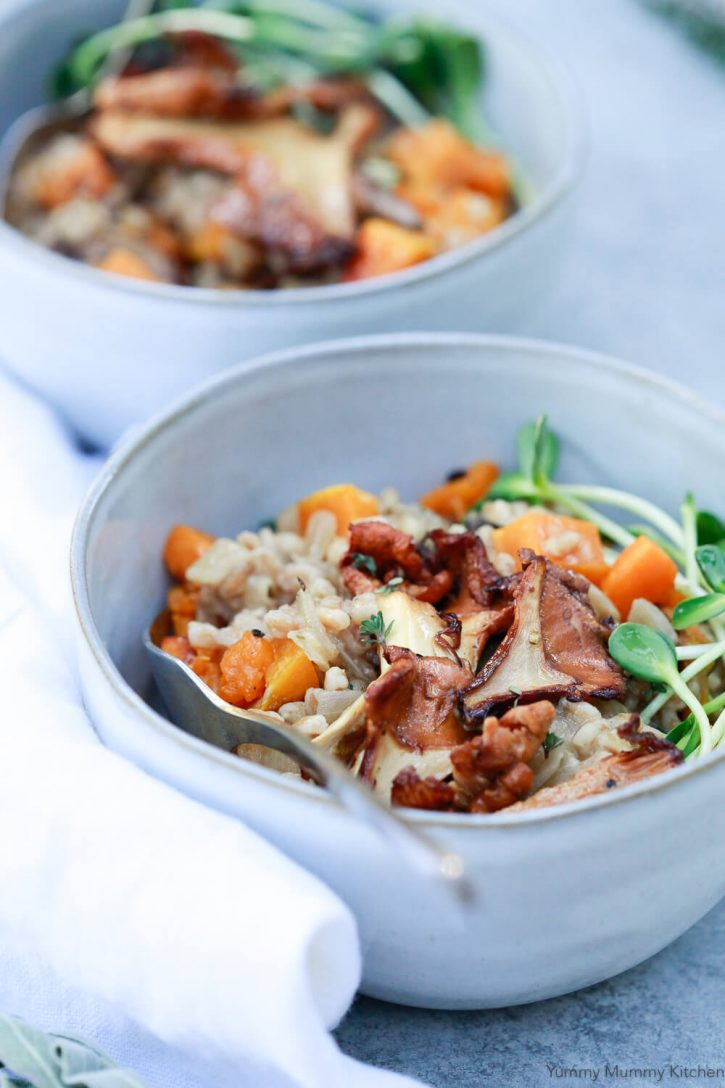 Close-up photography of a bowl of farrotto (farro risotto) with mushrooms and butternut squash.