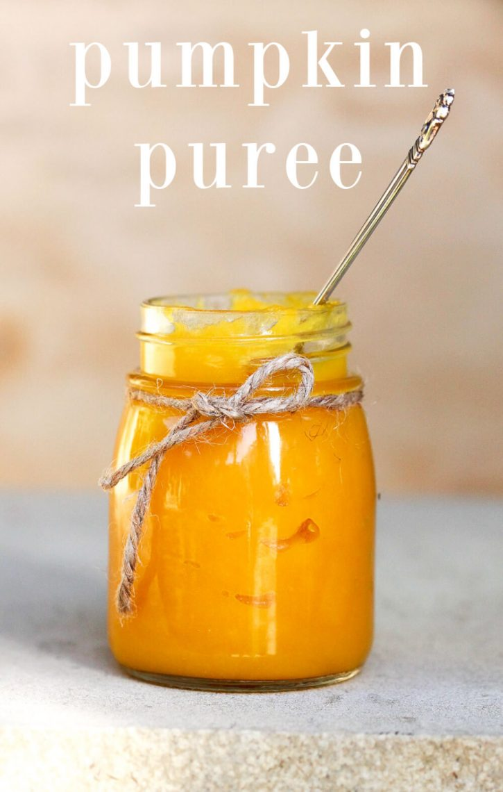A glass jar filled with homemade pumpkin puree. How to make pumpkin puree for pie, baked goods, and more. How to cook pumpkin, and pumpkin puree recipes.